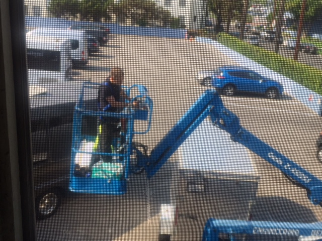 peeping tom in cherry picker trying to get away